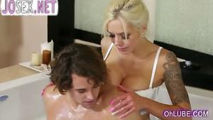 Amazing blonde doing massage in a warm bath