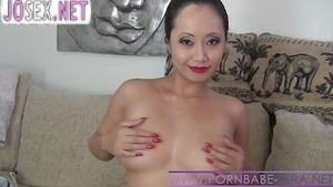 Beautiful Busty Asian chick caresses pussy...