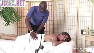 Black masseur Fucks a beautiful red-haired client....